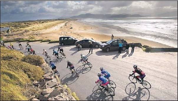 Cyclists passing Inch Beach